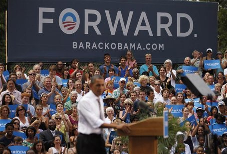 An audience listens to U.S. President Barack Obama during an election campaign rally in Colorado Springs, August 9, 2012. REUTERS/Jason Reed