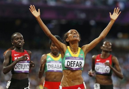 Ethiopia's Meseret Defar reacts after she won the women's 5000m final during the London 2012 Olympic Games at the Olympic Stadium August 10,