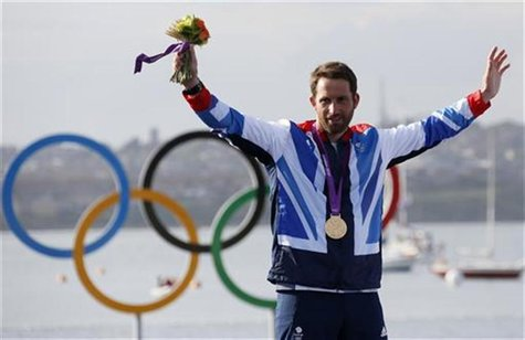 Gold medallist Britain's Ben Ainslie smiles during the men's finn class one person dinghy (heavyweight) sailing medal race victory ceremony