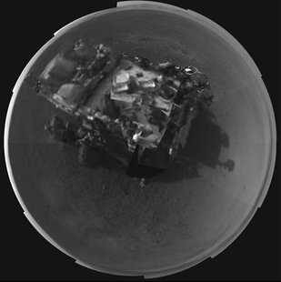 The Curiosity rover is seen in this stitched image taken by its Navigation cameras, located on the now-upright mast, in this picture release