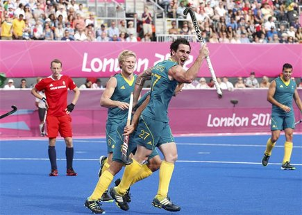 Australia's Kieran Govers (front) with team mate Matthew Butturini celebrates scoring a goal against Great Britain during their men's bronze