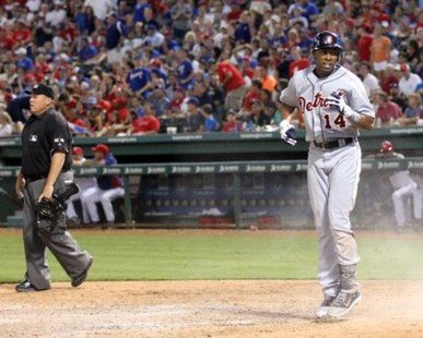 Detroit Tigers OF Austin Jackson jumps up after sliding home following an inside-the-park home run against the Texas Rangers in a game at Rangers Ballpark in Arlington, Texas on Aug. 10, 2012. (photo courtesy Detroit Tigers)