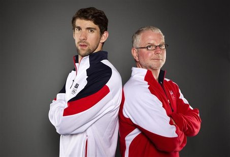 Swimmer Michael Phelps and his coach Bob Bowman (R) pose for a portrait during the 2012 U.S. Olympic Team Media Summit in Dallas, Texas May