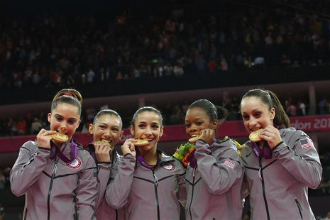 Team U.S.A members, Gabrielle Douglas (2nd R), Alexandra Raisman (C), Jordyn Wieber (R), McKayla Maroney (L) and Kyla Ross (2nd L) pose with
