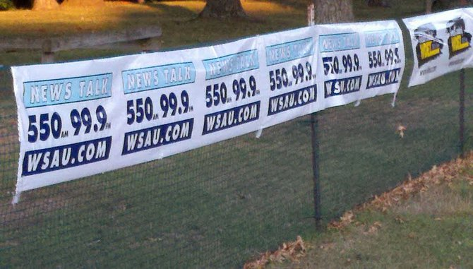 WSAU banners at the 2012 Mosinee Log Jam.