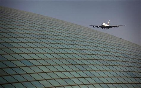 An Emirates airlines Airbus A380 comes in for landing over the roof of the Beijing Capital International Airport's train station March 6, 20