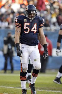 Chicago Bears middle linebacker Brian Urlacher walks off the field after the Seattle Seahawks scored a touchdown during the fourth quarter o