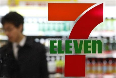 A customer is seen at a 7-Eleven convenience store in Tokyo April 5, 2012. REUTERS/Yuriko Nakao