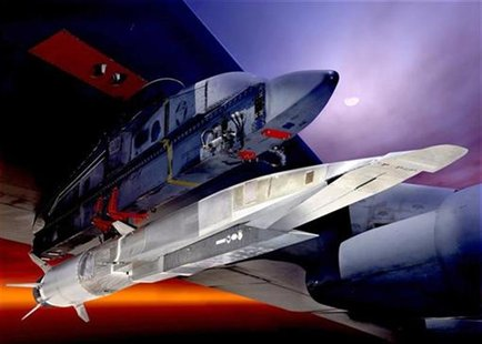 An undated U.S. Air Force handout graphic depicts the X-51A Waverider under the wing of a B-52 Stratobomber. REUTERS/US Air Force/Handout