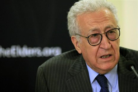 Diplomat Lakhdar Brahimi speaks with former U.S. President Jimmy Carter (not pictured) during a joint news conference in Khartoum May 27, 20