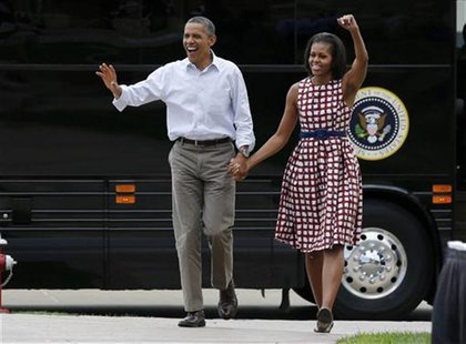 U.S. President Barack Obama and first lady Michelle Obama arrive by bus to speak at a campaign event at the Alliant Energy Amphitheater in D