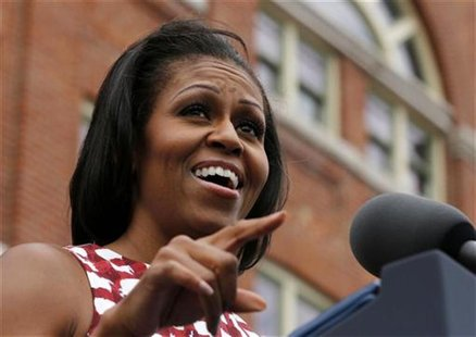 First lady Michelle Obama introduces U.S. President Barack Obama at an event at the Alliant Energy Amphitheater in Dubuque, Iowa, August 15,