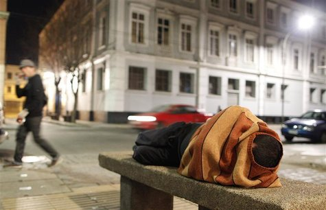 A homeless man sleeps on a cement bench in the downtown of Valparaiso, about 121 km (75 miles) northwest of Santiago, July 7, 2012. REUTERS/