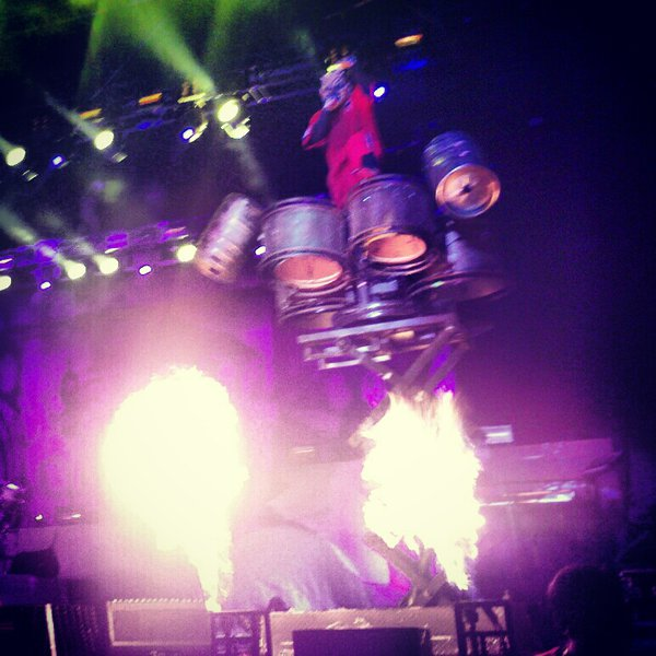Clown of Slipknot atop his hydraulic drum stand above some insane flames!  Photo by Jake Raflik.