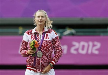 Russia's Maria Sharapova poses with her silver medal after receiving it during the presentation ceremony following the women's singles gold