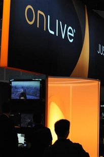 People preview video games at the OnLive booth at the Electronic Entertainment Expo (E3) in Los Angeles, California June 15, 2010. REUTERS/G