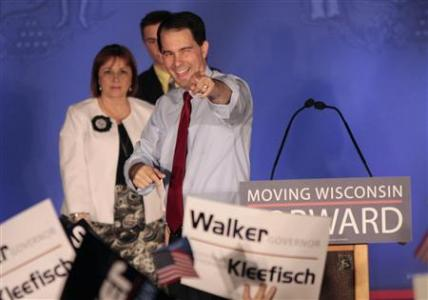 Republican Wisconsin Governor Scott Walker (C) celebrates his victory in the recall election against Democratic challenger and Milwaukee Mayor Tom Barrett in Waukesha, Wisconsin June 5, 2012.  Credit: Reuters/Darren Hauck
