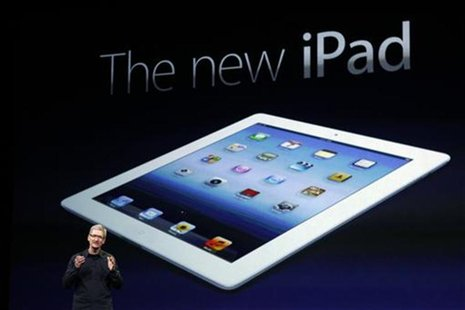 Apple CEO Tim Cook speaks during an Apple event as he introduces the new iPad as an image the device is projected on screen in San Francisco