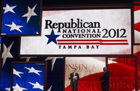 Republican National Committee Chairman Reince Priebus (C) unveils the stage for the upcoming Republican National Convention alongside conven
