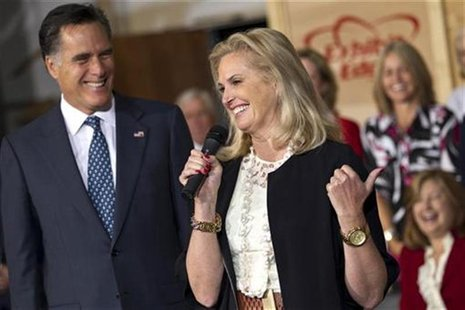 Republican presidential candidate and former Massachusetts Governor Mitt Romney smiles as his wife Ann Romney speaks during a campaign event