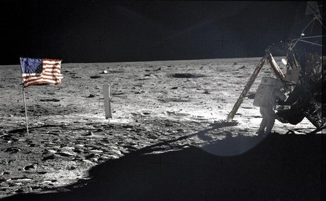 "This NASA file image shows U.S. astronaut Neil Armstrong, the Apollo 11 Mission Commander, standing next to the Lunar Module ""Eagle"" on the"
