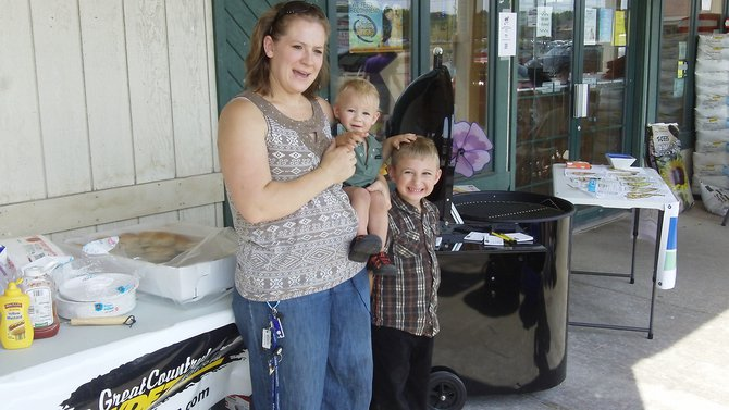 Congratulations Jolene Kostuch of Wittenberg! Jolene was the Grand Prize winner of the Woodmaster D400 Deck Pellet Grill. The kids are pretty happy about it, too.