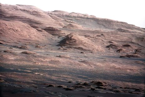 The base of Mars' Mount Sharp - the rover's eventual science destination - is pictured in this August 27, 2012 NASA handout photo taken by t
