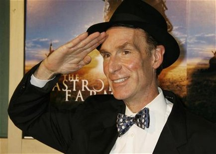 "Bill Nye, star of the television science program, ""Bill Nye the Science Guy"", poses as he arrives as a guest at the premiere of the film ""Th"