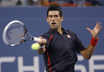 Novak Djokovic of Serbia returns a shot to Paolo Lorenzi of Italy during their match at the US Open men's singles tennis tournament in New Y