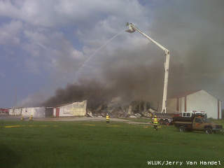 Firefighters battle a fire at a hay barn in the town of Oneida, Aug. 29, 2012. (courtesy of FOX 11).