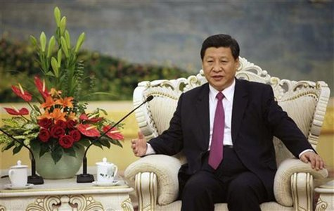 China's Vice President Xi Jinping speaks with Egypt's President Mohamed Mursi (not pictured) during a meeting at the Great Hall of the Peopl