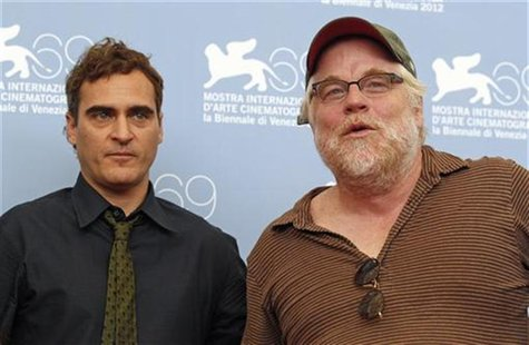 "U.S. actors Philip Seymour Hoffman (R) and Joaquin Phoenix pose during a photocall for the movie ""The Master"" at the 69th Venice Film Festiv"