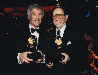 Lyricist Hal David (R) and composer Burt Bacharach pose after receiving the Grammy Trustee Award in 1997, in this undated handout photo. REU