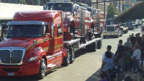 The big rigs coming down 8th Street in front of the Marketplace outside of the Holland Civic Center during the 2012 Holland/Zeeland Community Truck Parade on Sept. 3, 2012.