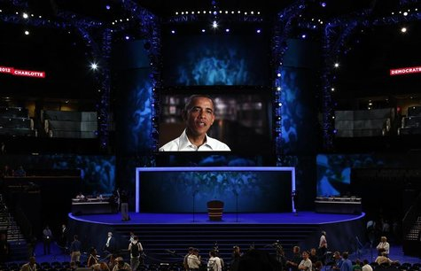 U.S. President Barack Obama is seen on a video screen during preparations at the venue for the Democratic National Convention in Charlotte,