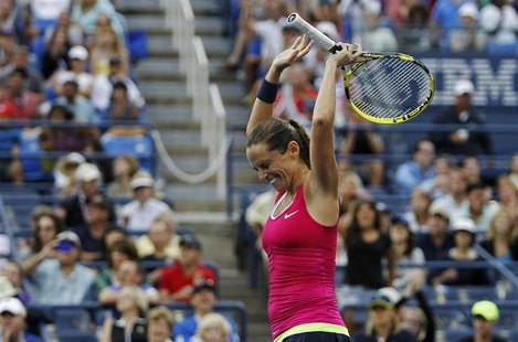 Roberta Vinci of Italy celebrates after defeating Agnieszka Radwanska of Poland in their women's singles match at the U.S. Open tennis tourn