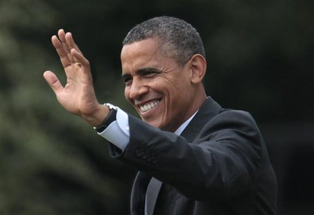REFILE CORRECTING MONTH U.S. President Barack Obama waves as he walks on the South Lawn of the White House in Washington before his departur
