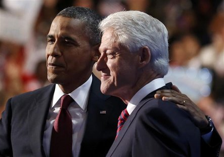 U.S. President Barack Obama (L) embraces former President Bill Clinton onstage after Clinton nominated Obama for re-election during the seco