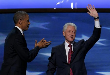 U.S. President Barack Obama (L) joins former U.S. President Bill Clinton onstage after Clinton nominated Obama for re-election during the se