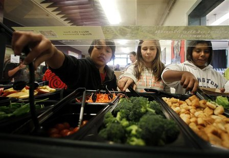 Students get their lunch from a salad bar at the school cafeteria as some of more than 8,000lbs of locally grown broccoli from a partnership