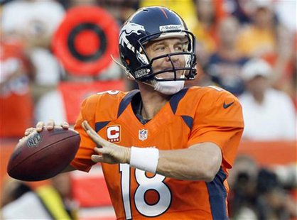 Denver Broncos quarterback Peyton Manning prepares to throw against the Pittsburgh Steelers during their NFL football game in Denver Septemb
