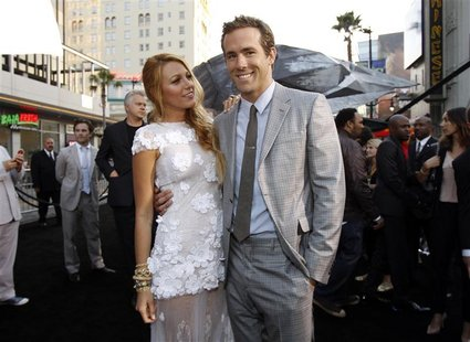 "Cast members Ryan Reynolds and Blake Lively pose at the premiere of ""Green Lantern"" at the Grauman's Chinese theatre in Hollywood, Californi"