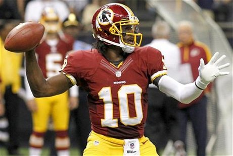 Washington Redskins quarterback Robert Griffin III (10) drops back to pass as his team takes on the New Orleans Saints during their NFL foot