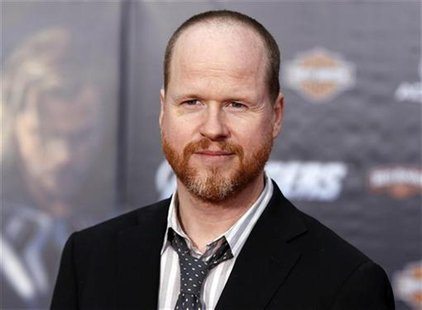 "Director Joss Whedon poses at the world premiere of the film ""Marvel's The Avengers"" in Hollywood, California April 11, 2012. REUTERS/Danny"