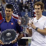 Britain's Andy Murray (R) and Serbia's Novak Djokovic hold their trophies after Murray defeated Djokovic in the men's singles final match at