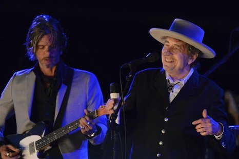 U.S. musician Bob Dylan (R) performs on the second day of the Hop Farm Music Festival in Paddock Wood, Kent June 30, 2012. REUTERS/ Ki Price