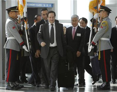 Israel's Deputy Prime Minister Dan Meridor (front) arrives at the Incheon International Airport ahead of the Nuclear Security Summit in Seou