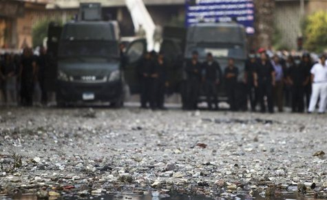 Stones thrown during clashes between riot policemen and protesters lie on a road leading to the U.S. embassy, near Tahrir Square in Cairo Se