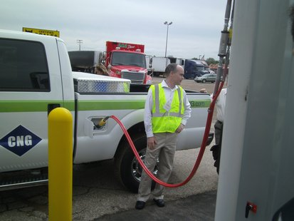 CNG (Compressed Natural Gas) vehicle being filled with fuel