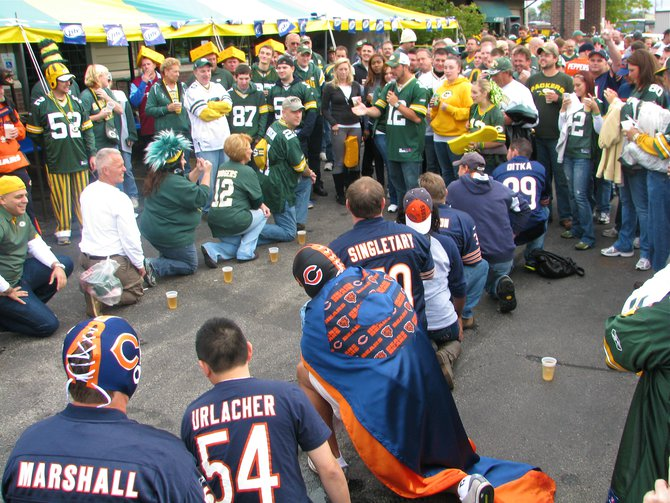 Packers vs Bears fans in a relay drinking game